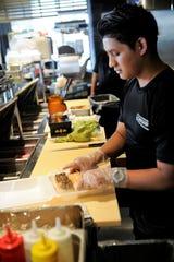 Sebastian Tomas prepares sushi to go at Wasabi Evansville on Saturday, Apr. 4, 2020.