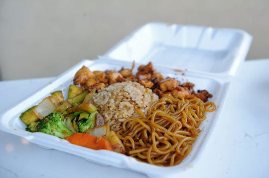 A dinner hibachi meal with salmon, fried rice, vegetables and noodles at Wasabi Evansville.