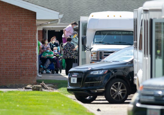 Residents of Washington Nursing Center at 603 E. National Hwy in Washington, Ind., are loaded onto buses to transport to another Chosen Healthcare facility in Hanover, Ind., Monday afternoon, April 6, 2020. The company allegedly wants to house COVID-19 patients at the Washington facility.
