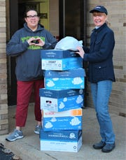 Kathy Jo Schweitzerdropsoffboxes of snacks to Pam Bacon, Port Clinton City School Distirct Food Service Director.