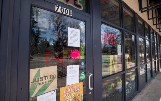 One Love remains open despite legal action from Larimer County officials to close the smoke shop amid a public health order during the coronavirus pandemic in Fort Collins, Colo. on Monday, April 6, 2020.