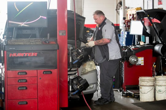 Ryan Spencer tests a battery at Terry Wynter Auto Service Center in Fort Myers on Monday, April 6, 2020.