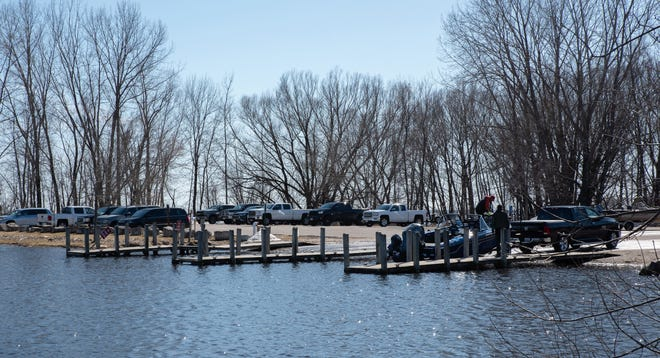Anglers trailer out a boat at North Bay Shore Park on after fishing on the Bay of Green Bay Saturday afternoon.