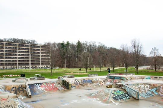 An unidentified skateboarder grinds a rail while doing a lap around the park after a rain shower, Monday, April 6, 2020, at the Iowa City Skate Park in Iowa City, Iowa. Skate parks were one of the additional spaces ordered to be closed by Iowa Gov. Kim Reynolds during a Monday morning press conference on the novel coronavirus, COVID-19.