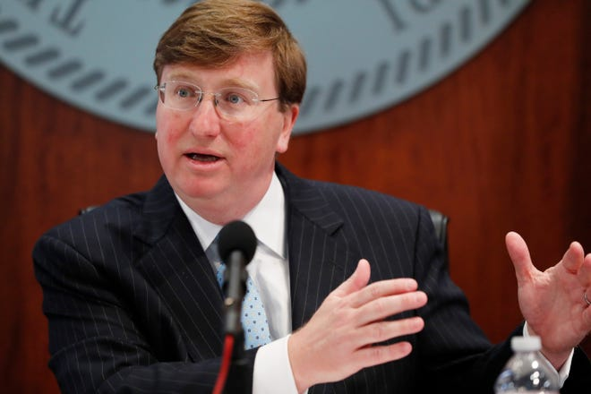 Mississippi Gov. Tate Reeves discusses how the state is responding to COVID-19 as the numbers of deaths and of those people who have tested positive with the disease continues to rise, during his news conference in Jackson, Miss., Monday, April 6, 2020. Prior to taking questions, Reeves provided a detailed briefing on hospital surge plans. (AP Photo/Rogelio V. Solis)