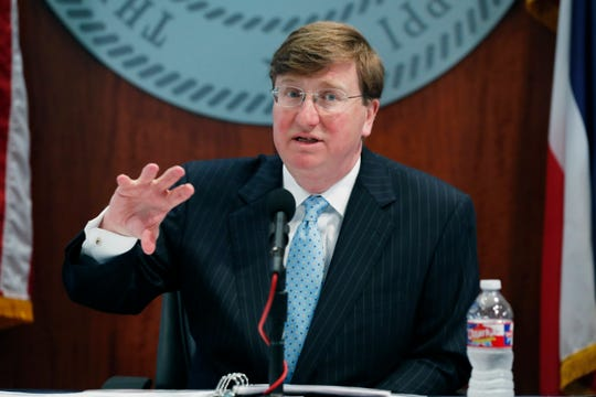Mississippi Gov. Tate Reeves discusses how the state is responding to COVID-19 coronavirus as the numbers of deaths and of those people who have tested positive with the disease continues to rise, during his news conference in Jackson, Miss., Monday, April 6, 2020. (AP Photo/Rogelio V. Solis)