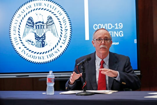 Jim Craig, senior deputy and director of health protection at the  Mississippi State Department of Health, answers a reporter's question at the governor's news conference in Jackson, Miss., Monday, April 6, 2020. (AP Photo/Rogelio V. Solis)