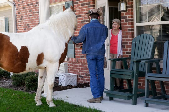 Horses visit with residents at Aster Place, Monday, April 6, 2020 in Lafayette.