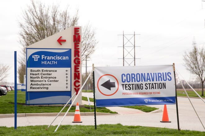 A sign for a Coronavirus testing station at Franciscan Health Lafayette East hospital directs patients, Monday, April 6, 2020 in Lafayette., Monday, April 6, 2020 in Lafayette.