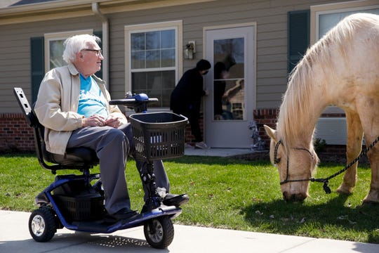 Charlie Long visits with Goldie while going for a walk around Aster Place, Monday, April 6, 2020 in Lafayette.