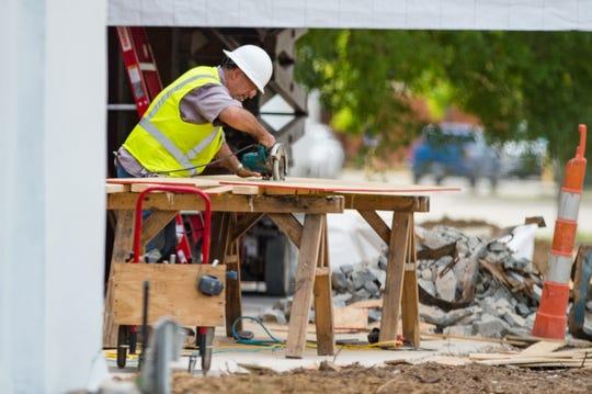 Commercial building construction along Ambassador Caffery Pkwy.  Monday, April 6, 2020.