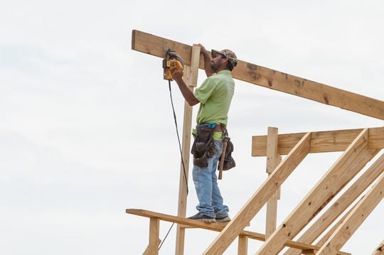 Home construction in The Woodlands development on Verot School Rd.  Monday, April 6, 2020.