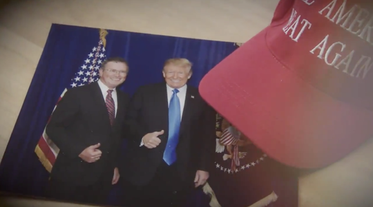 A screen capture from Rep. Thomas Massie's new campaign ad shows him together with President Donald Trump.