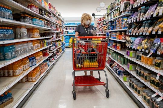 Gail Churinetz retrieves food items for a Shipt customer at Target, Monday, Apr. 6, 2020, in Germantown, TN.