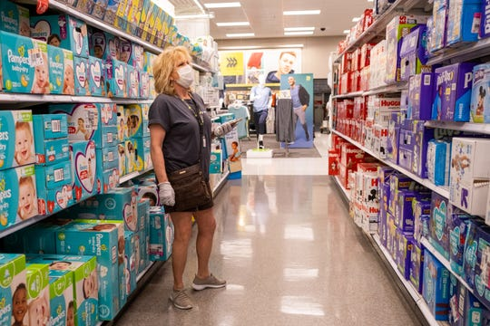 Gail Churinetz, who is working for Shipt, looks for a customer's diaper order inside Target, Monday, Apr. 6, 2020, in Germantown, TN.