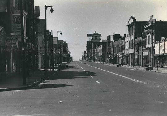 Riot: North Third Street (now King Drive) is almost deserted on July 31, 1967, the day after a riot erupted in the north side neighborhood. Mayor Henry Maier declared a state of emergency and urged people to stay home. This photo was published in the Aug. 1, 1967, Milwaukee Sentinel.