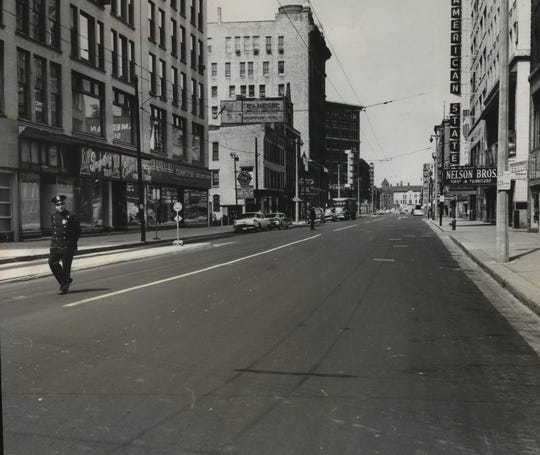 Civil defense: Police patrol a deserted downtown Milwaukee after air raid sirens sent motorists and pedestrians scurrying for cover as part of a civil defense drill on April 17, 1959. This photo, taken looking north on Plankinton Avenue from Wisconsin Avenue, was on the front page of the April 17, 1959, Milwaukee Journal.