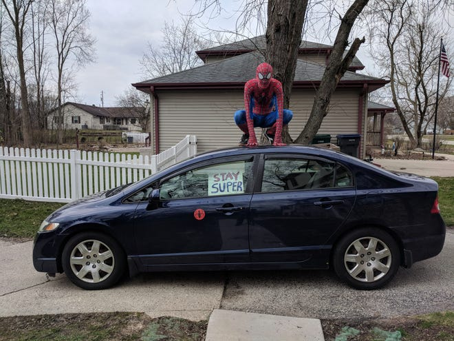 """Mike Justman of New Berlin dresses up as Spider-Man and drives around the community, making stops at homes and reminding kids to """"Stay Super"""" during the COVID-19 pandemic."""