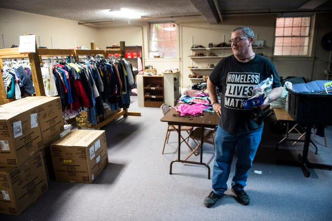 Patrick Aitken shows a donated clothes closet that is currently closed due to the coronavirus at River City Church in Montgomery, Ala., on Monday, April 6, 2020.
