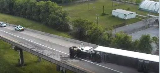 An overturned tractor trailer shut down an on ramp from I-85 south to I-65 South.