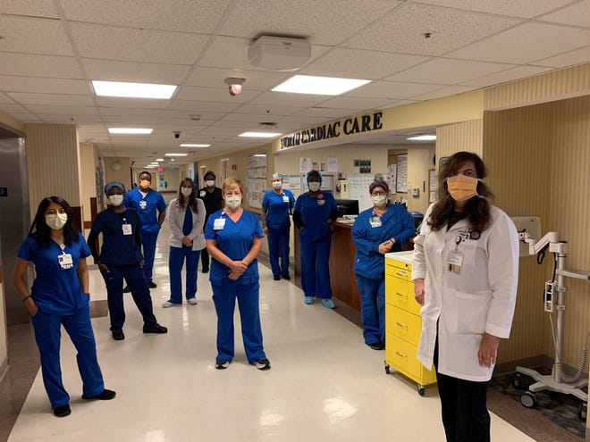 Dr. Bendeck stands with her colleagues who are also fighting the coronavirus for our community at Naples Community Hospital.