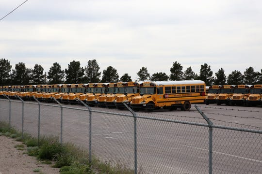 School buses parked at the Las Cruces headquarters of contractor STS of New Mexico on Monday, April 6, 2020.