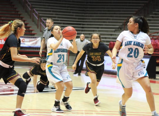 Navajo Prep's Holly Walker (21) passes the ball to teammate Aiona Johnson (20) against Tohatchi during the 3A girls basketball state championship game on Friday, March 13, 2020, at Dreamstyle Arena in Albuquerque. Walker will play for the North's small-school team in the 2020 All-Star game.