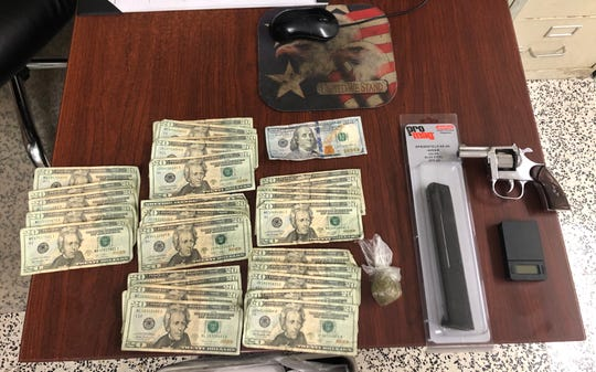 Opelousas Police said they found stolen money, a gun and drugs at a home.