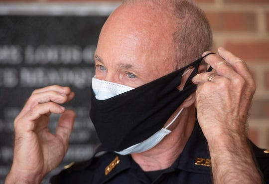 Pensacola Police Department Lt. Steve Bauer demonstrates on Monday how to use the department's new personal protection equipment to help combat the COVID-19 pandemic.