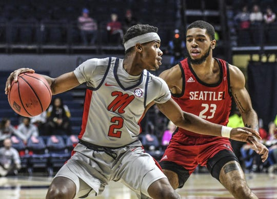 Mississippi guard Devontae Shuler (2) is defended by Seattle guard Terrell Brown (23) during an NCAA college basketball game Tuesday, Nov. 19, 2019, in Oxford, Miss.