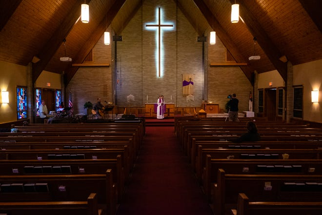 Rev. Mark Huff preaches to a video camera in an empty sanctuary on Palm Sunday, April 5, 2020, at Faith Lutheran Church in Port Huron.