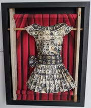 "Emerge Gallery's virtual exhibit features Cheryl Lickona's ""Snapshot,"" a three-dimensional dress fashioned from photographic paper strips."