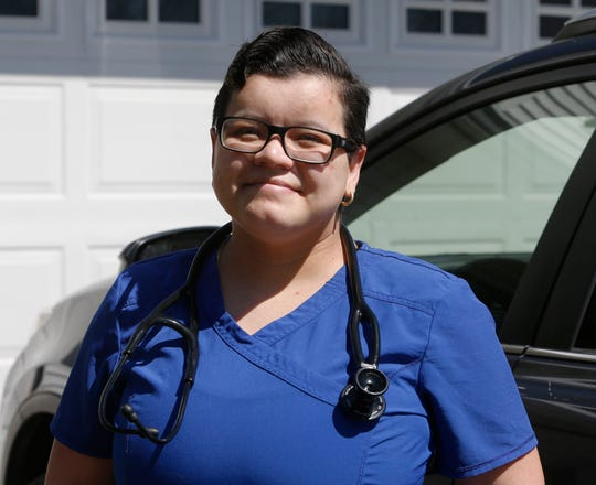 Diana Gomez outside her home in the Town of Poughkeepsie on April 6, 2020. Gomez is currently a nursing student at Mount Saint Mary College and works at Vassar Brothers Medical Center.