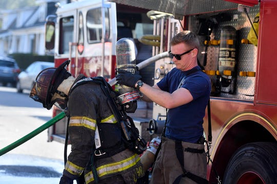 Fire fighters from York City and YAUFER douse a blaze in a garage to the rear of 164 E. Cottage Place, Monday, April 6, 2020. A car and a motorcycle were among items damaged in the blaze. John A. Pavoncello photo