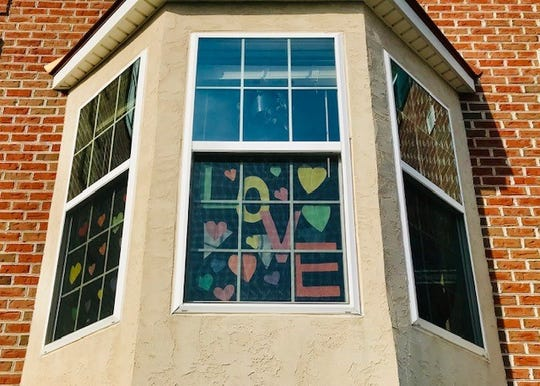 The Woodall kids are adding hearts in all their windows to share love with walkers in the community.