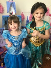 Noelle, 5, and Zoe, 6, dress up for homeschooling every day.