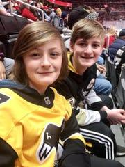 Dimitri, 11, and Ty, 13, really miss hockey season.