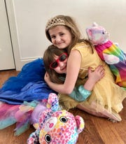 Noelle, 5, and Zoe, 6, dress up every day for school at home.