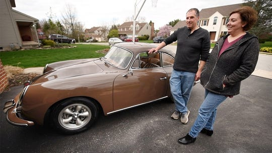 Jim, left, and Tracey Cullen with a 1960 Porsche 356B 1600 Super. Her father bought the car in 1981, to fix up. The couple completed the job starting in 2002. They are selling it to pay for their daughter's college education.