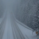 Snow continues to fall heavily on Interstate 80 in California on the evening of April 5, 2020.