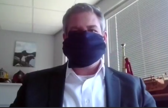 Monroe County Executive Adam Bello demonstrates a homemade cloth mask during a video conference on April 6, 2020.