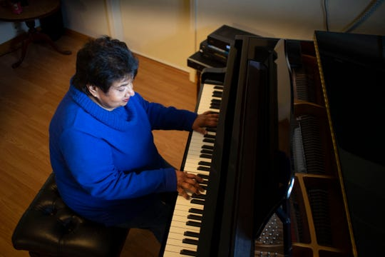 Conica Patnaik of Redding teaches an online piano class from her home.