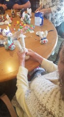 Sundial Assisted Living residents work on crafts. No visitors are allowed at the Redding center, where the average age is 96.