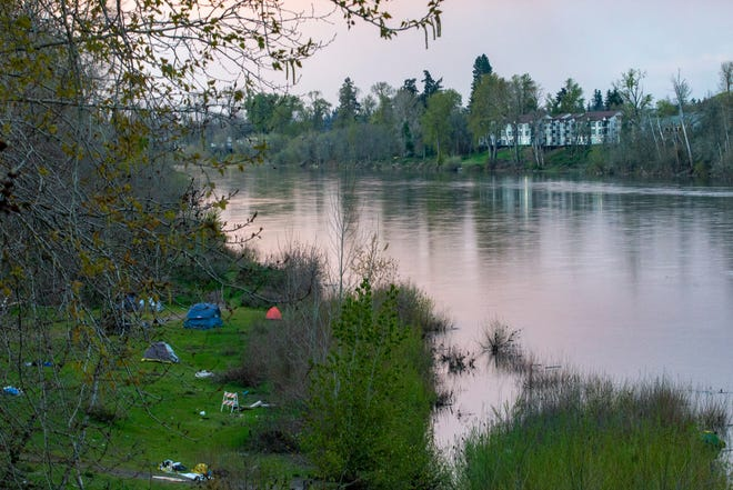 A homeless camp stretches across the banks of Wallace Marine Park in Salem, Oregon, on Tuesday, March 31, 2020.