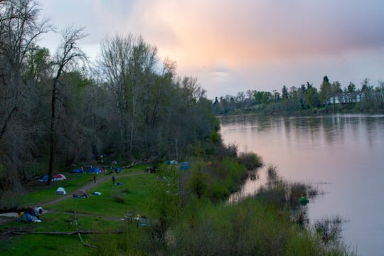 After the Salem City Council rescinded a camping ban in mid-March, a homeless camp stretched across the banks of Wallace Marine Park in Salem, Oregon, on March 31, 2020.