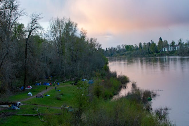 Ever since the Salem City Council rescinded a camping ban in mid-March to help reduce unsheltered people's exposure to COVID-19, a homeless camp has stretched along the river bank at Wallace Marine Park in West Salem.