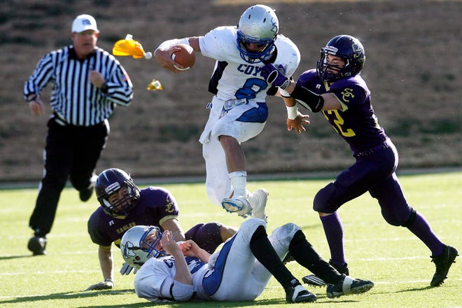 Richland Springs High School's Denim Reeves leaps over a teammate during the Coyotes' 46-0 win over Sterling City in the state final Dec. 11, 2010.