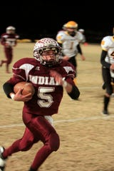 Paint Rock's Tony Diaz (5) runs down the sideline for a touchdown in the Indians' 2010 playoff opener against Loraine. Diaz suffered a knee injury in the game, and Loraine rallied for a 70-63 win.