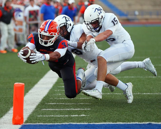 Central High School's Daven Manning dives for the end zone against Byron Nelson on Sept. 4, 2015, at San Angelo Stadium.