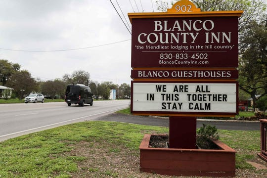 A sign at the Blanco County Inn urges calm amid the coronavirus pandemic, even as few cases have been reported in Blanco County and the surrounding Hill Country.